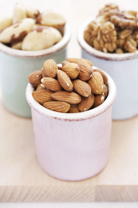 Research has linked snacking on nuts with having a lower waist circumference. Nuts are rich in monounsaturated fats, making them a more satisfying pick than pretzels. Make sure you stick to the unsalted versions to stave off sodium-induced puff, and keep in mind one serving is about a small handful.