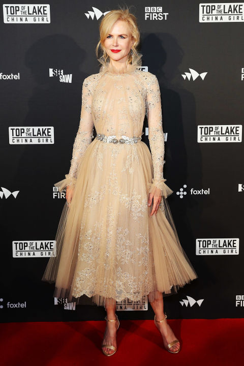 Who: Nicole Kidman When:August 1, 2017 Wearing: Zuhair Murad Why: Nicole Kidman arrived at theTop of the Lakepremiere in Sydney, Australia looking like aporcelain doll that sits in your chic grandma's untouchable living room. Her complexion-flatteringnude ensemble—completewith a barely-there tulle collar—wins the actress best dressed of the week.