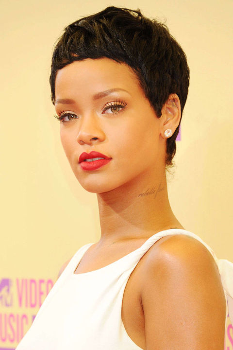 "At the MTV VMAs, Rihanna took home the award for best video of the year for ""We Found Love,"" and also put together one of our favorite beauty looks of the year, with the debut of her pixie cut that looked downright stunning with bright red lipstick and a white gown."