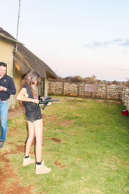 Ella trying a Tranquilliser Gun Naankuse Wildlife Sanctuary Namibia