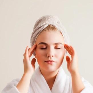 person massaging face