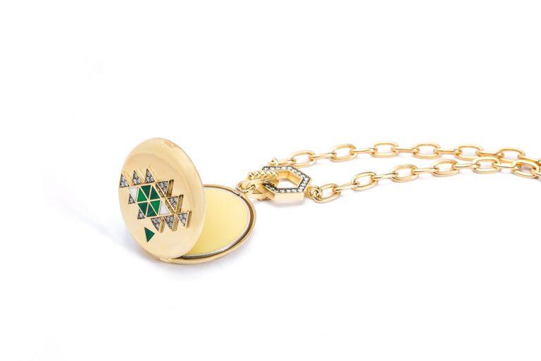 Open necklace pendant showing CBD balm, jewelry product photographer Ella Sophie, Oakland CA