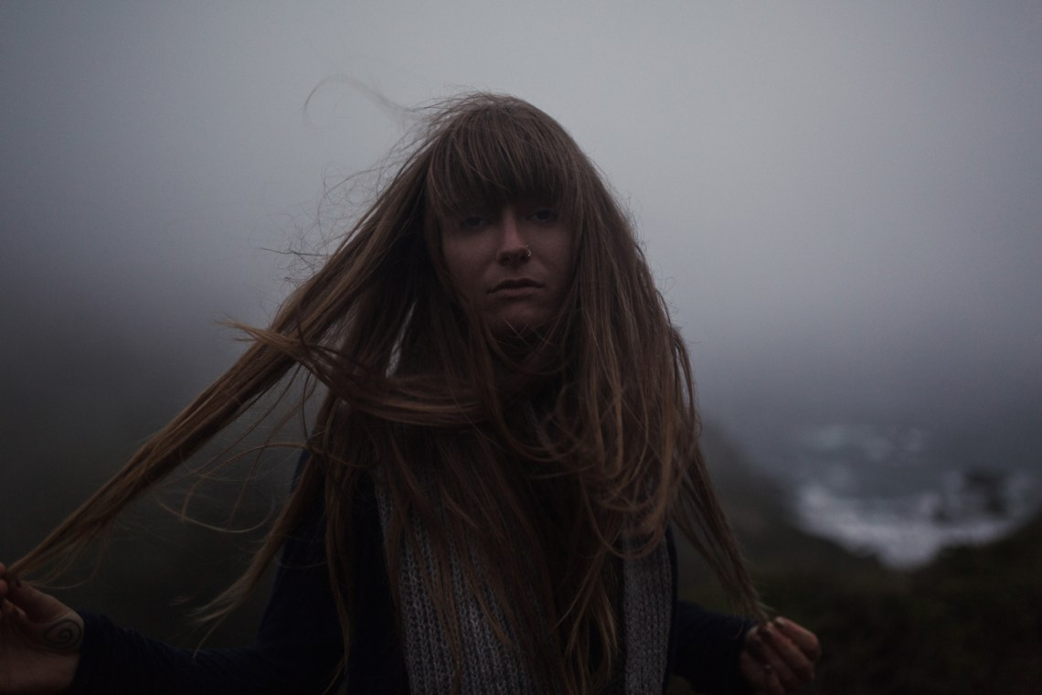 wild and free lifestyle photography by NorCal photographers Ella Sophie. Model Vera Vinot with knitwear at muir beach.