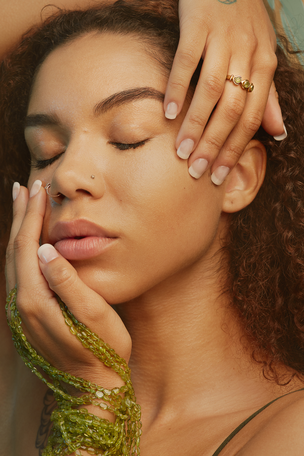 Peridot jewelry ad image, dreamy portrait with hands on face by SF jewelry photographer Ella Sophie