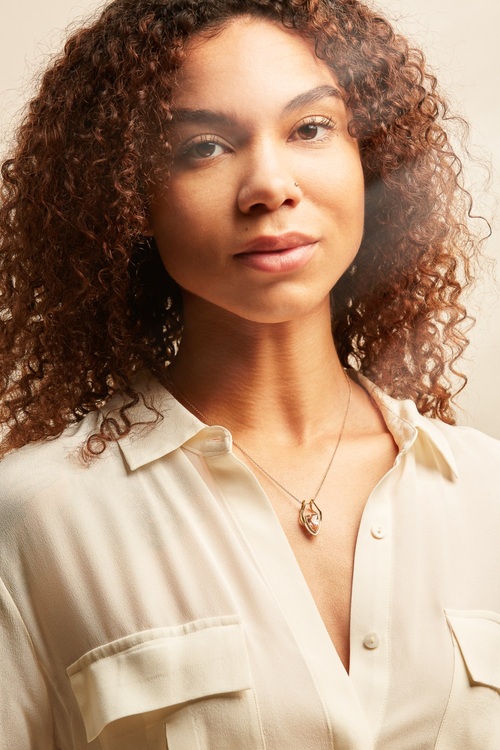 confident, empowered jewelry look book showing model with natural hair