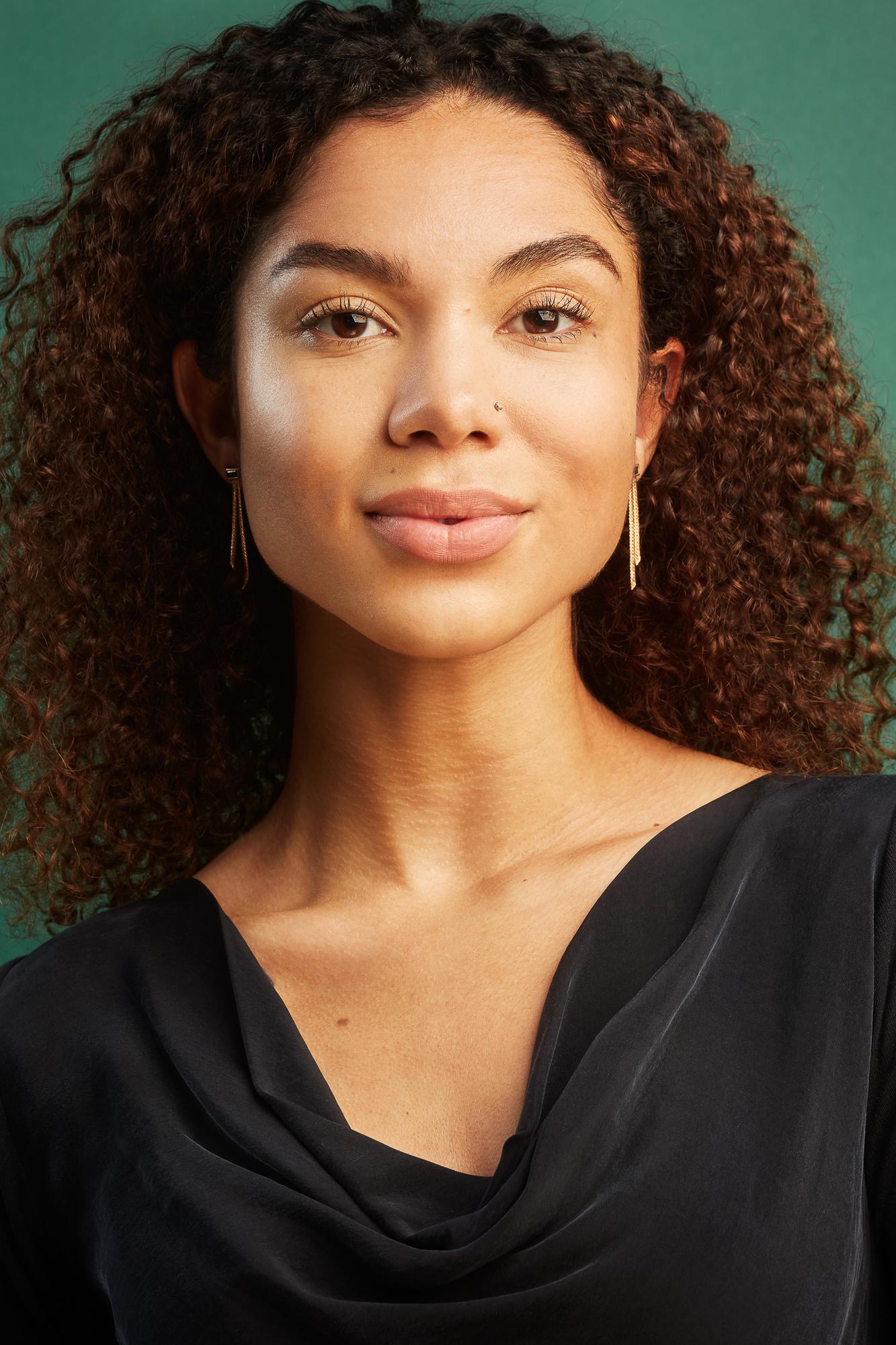 Earrings on model, portrait of Alyssa Jade wearing Mercurius vintage earrings