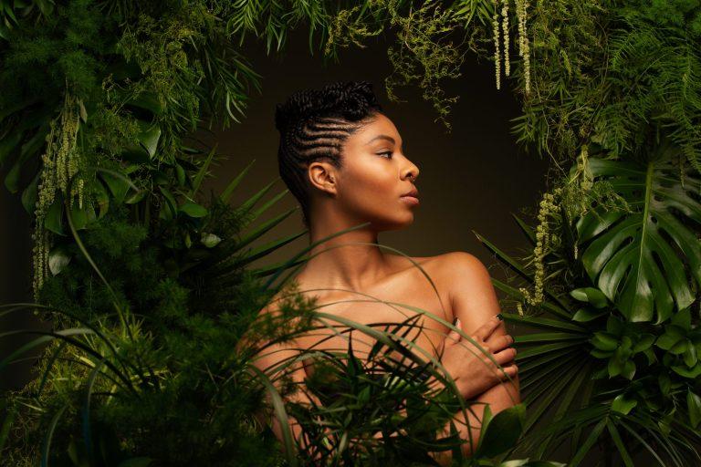 Beauty portrait in green plant environment By women's empowerment photographer Ella Sophie