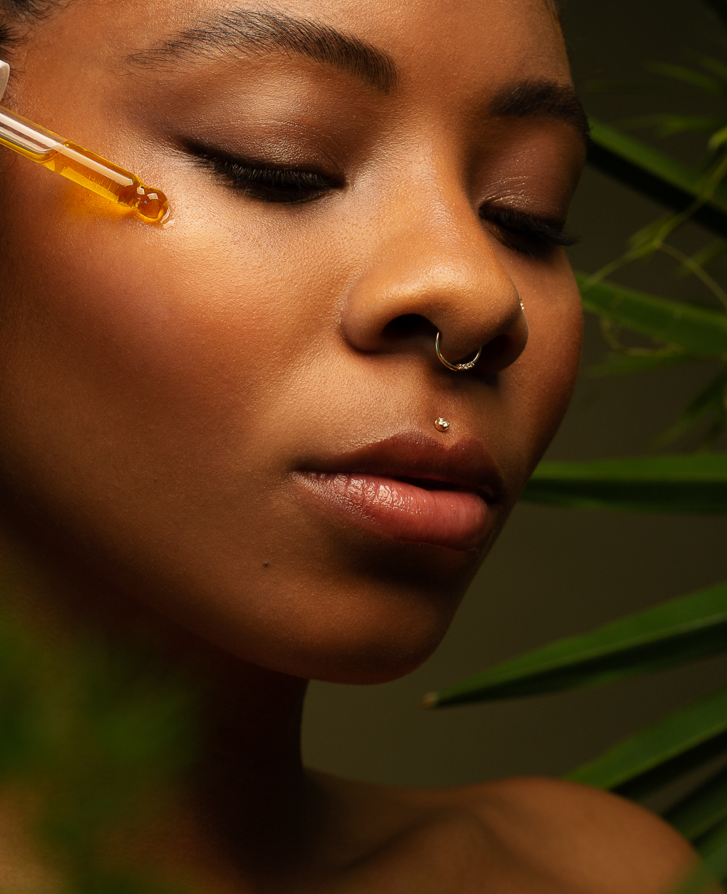 Close up beauty portrait of black skin and face serum by woman photographers Ella Sophie, Oakland