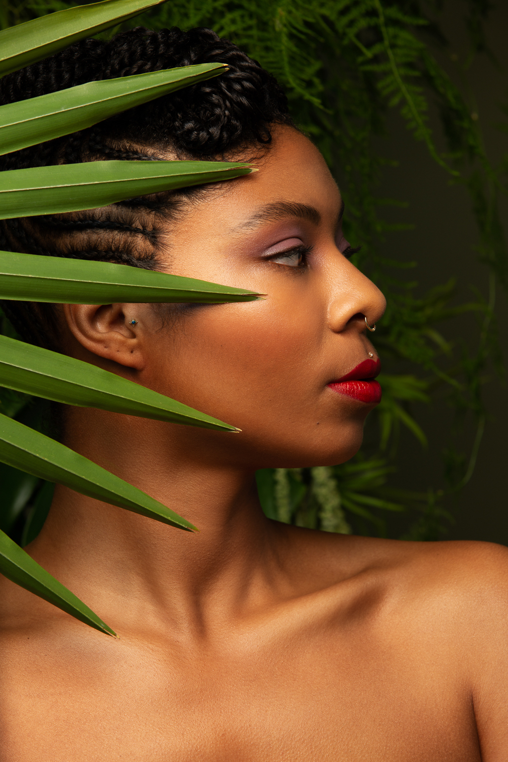 Profile view of woman with plants, cbd skincare advertising image by beauty photographer Ella Sophie