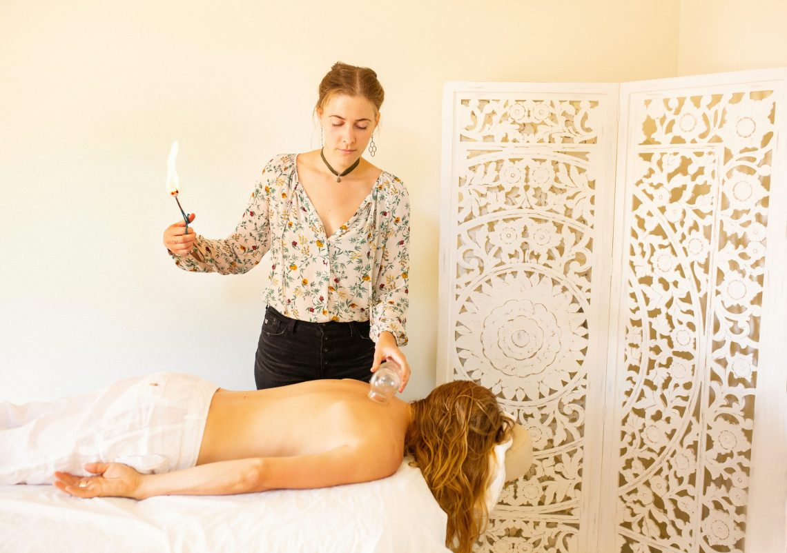 Warm lifestyle branding image showing Dr. preparing cupping for Chinese medicine treatment. Photography byEllaSophie, Oakland CA. Marketing for women owned wellness company.