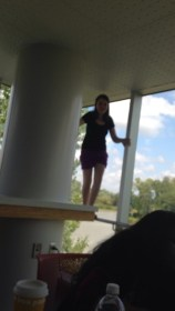 Rachel in her natural habitat (standing on safety bars is a hobby of hers). It's a little blurry but this is the kitchen/lounge right across from our room. As you can see there is another lovely view of the lake (which I love, clearly).