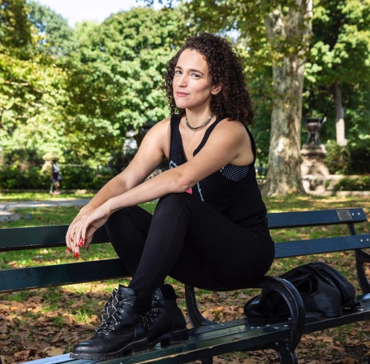 Danielle Blunt sitting on a bench in the park.