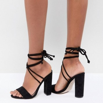 Public Desire, Suzu Black Tie Up Black Heels. Sizes UK 3 - 8. £29.99. https://www.asos.com/public-desire/public-desire-suzu-black-tie-up-block-heeled-sandals/prd/9400606?clr=black-faux-su&SearchQuery=&cid=6461&gridcolumn=3&gridrow=4&gridsize=4&pge=1&pgesize=72&totalstyles=970