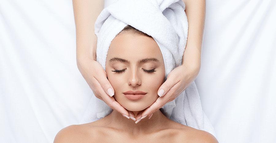 woman receiving facial eyes closed acne facial ellemes medical spa atlanta