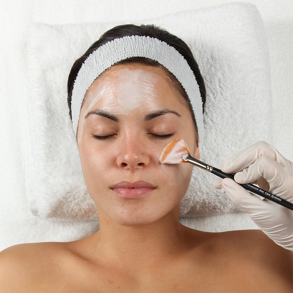 woman receiving a chemical peel ellemes medical spa atlanta