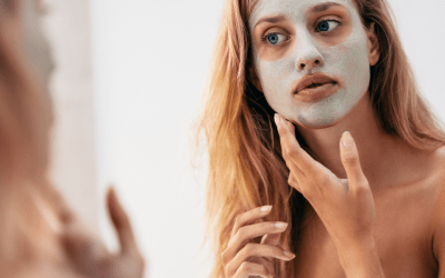 woman lookin in mirror wearing face mask atlanta medical spa