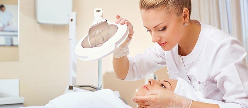 atlanta esthetician looking at patients skin