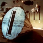 13' L x 8' diameter, Wooden cone, 12 mixed media objects on motor, 7 columns with shadow pictures, 1991-92