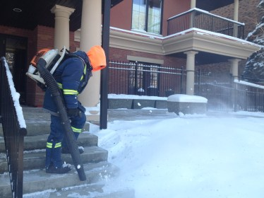 A snowblower clears the sidewalks. Home owners and businesses must clear the sidewalks within 48 hours of snowfall. There's a lot of equipment for this!