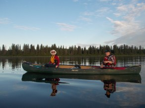 Friends from the paddling club enjoy the peaceful evening paddle.