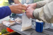Mixing up the dough for Bannock for breakfast