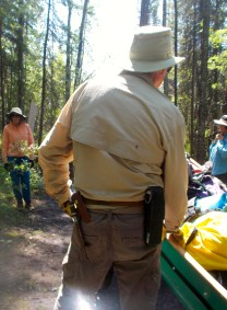 Doug is well-equipped (knife and bearspray) for our portage.