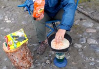 Making a quesadilla in camp