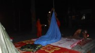The monks were determined to hang a mosquito net. They even put poles in the ground
