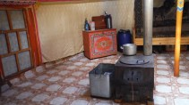 The stove inside the ger, heated by... Dried animal poo