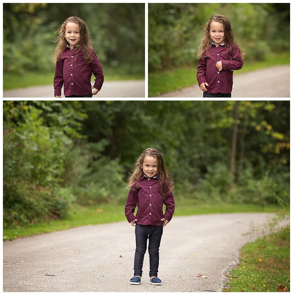little boy in maroon shirt poses on a path in beachwood