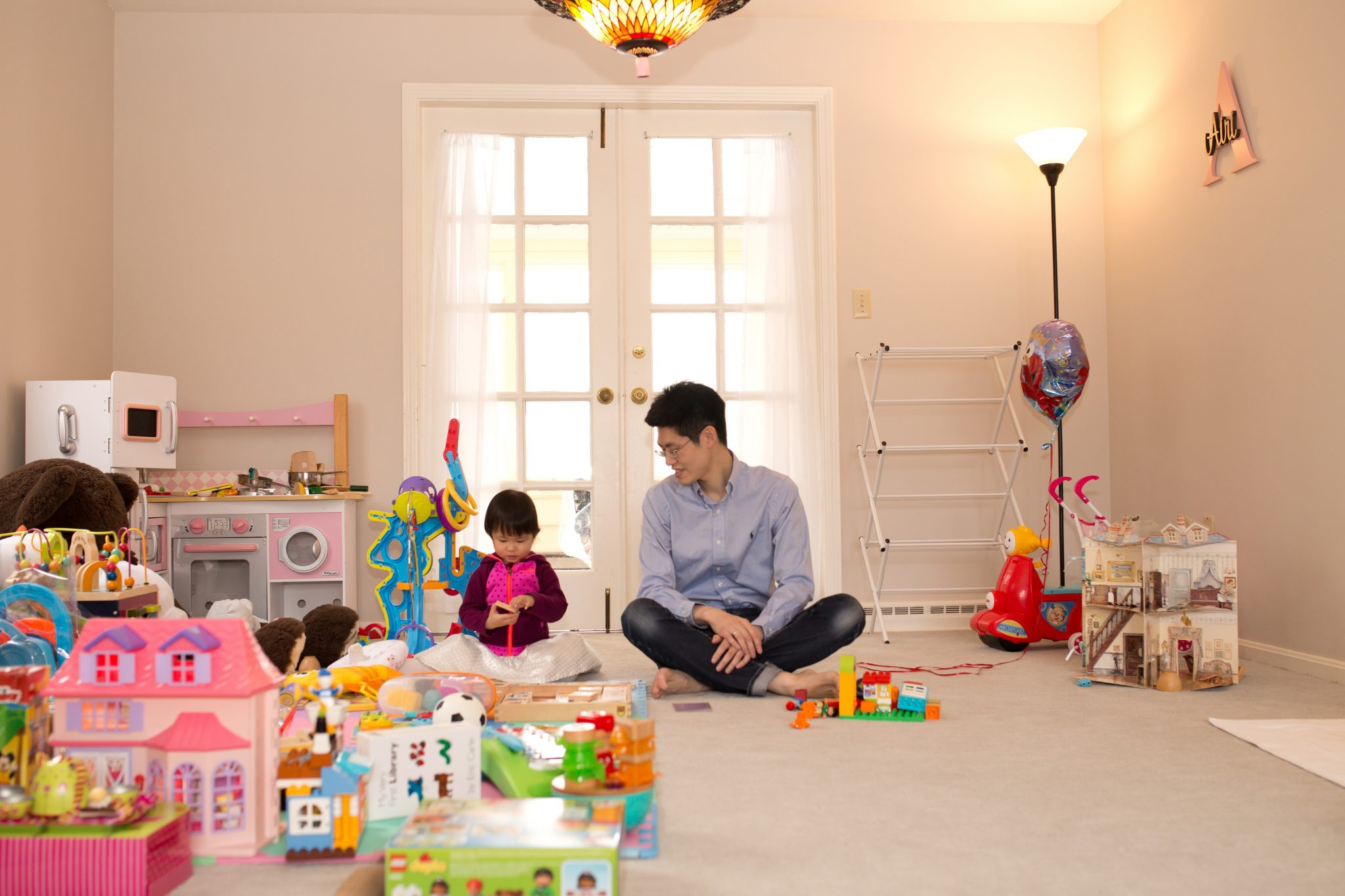 father and daughter in playroom during lifestyle session