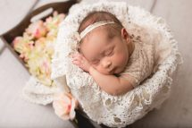 newborn baby girl in a bucket