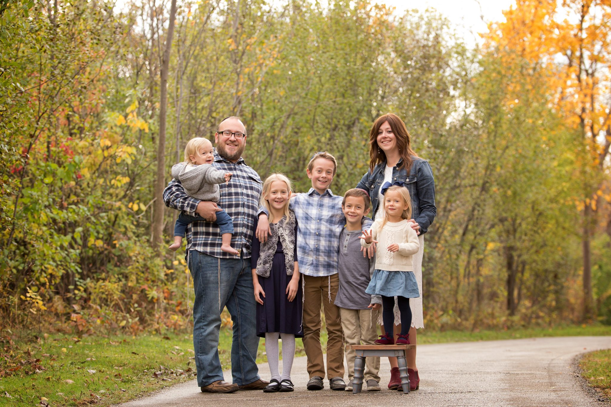 family of seven poses for their fall portrait session