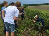 David Leach taking a group of BTO Young Birders out foraging for nests (Image - Max Hellicar)
