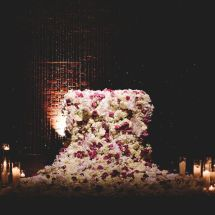 luxurious sweetheart table, candles, waterfall of flowers