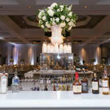 large centerpiece, bar, candles, greenery