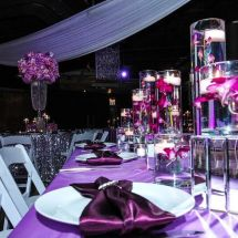 large centerpiece, candles, cylinder, purple