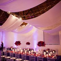 red florals, candles, drape