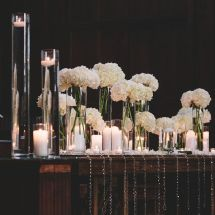candles, cylinder vases, flowers, jewels
