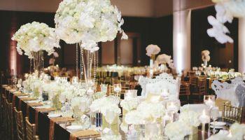 white centerpieces, orhicds, roses, hydrangeas
