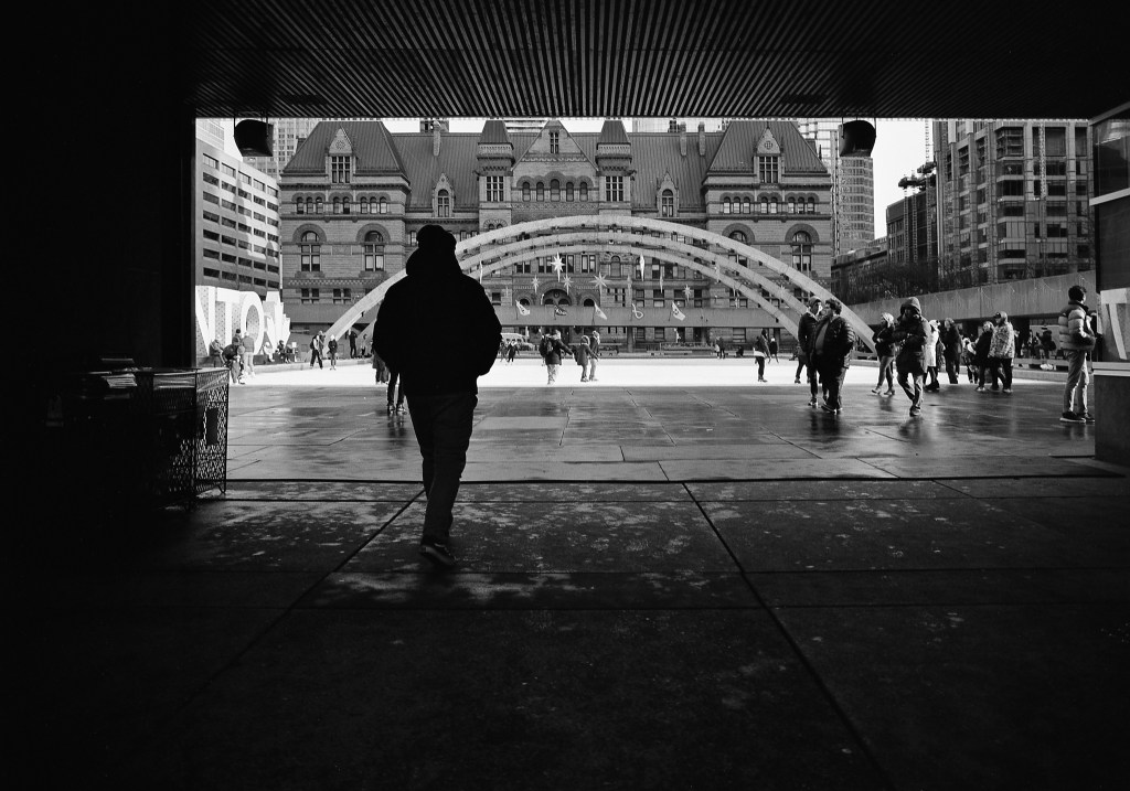 a black and white photo of nathan phillips square in toronto