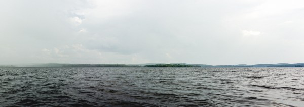 A panorama image of an island in a lake.