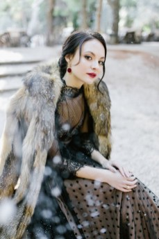 Winter bride in black and fur coat winter wonderland
