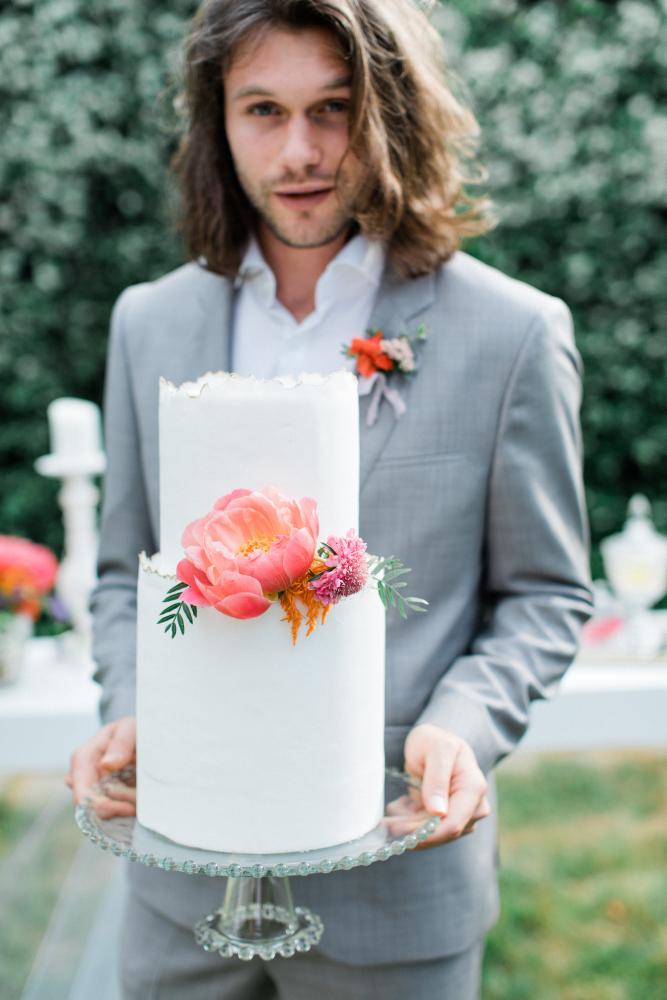 Groom with white wedding cake