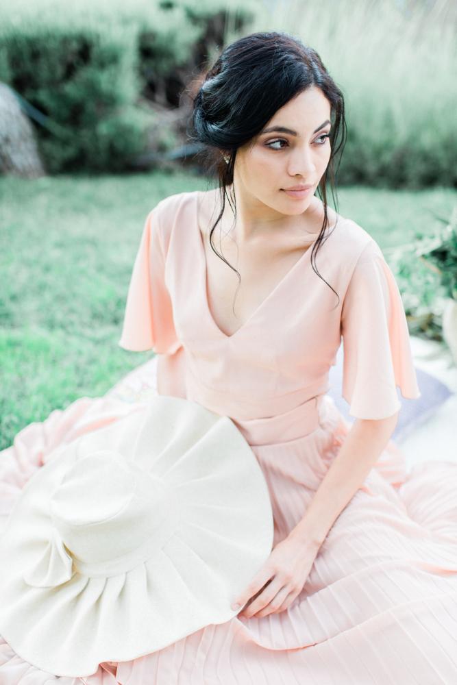 Girl sitting at the lakeside picnic