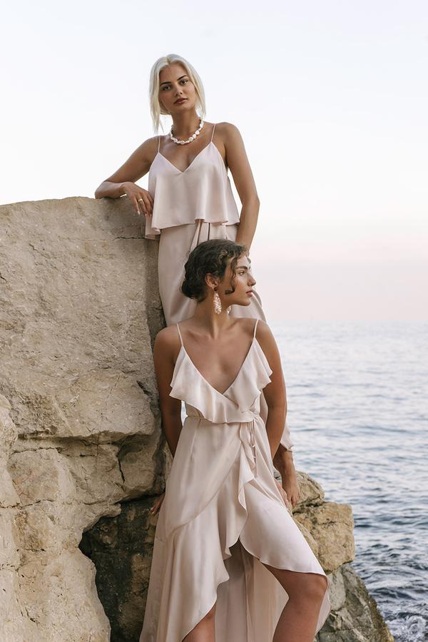 two bridesmaids by the sea wearing Shona Joy Evie by Bridesmaids Only