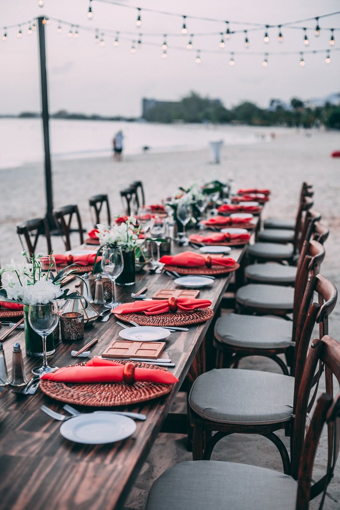 Destination Bridal Shower Table Setup on the Beach with rustic Chairs and fairy lights