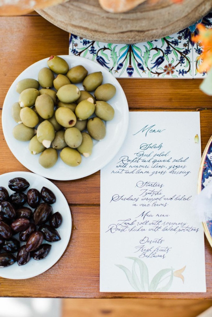 Greek olives and menu for the Welcome Dinner Inspiration