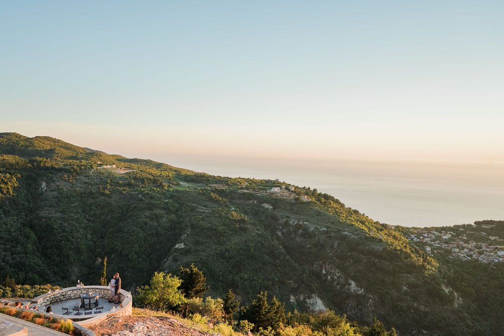 Same-sex vow renewal in Lefkada with gorgeous view of the mountain and the sea.