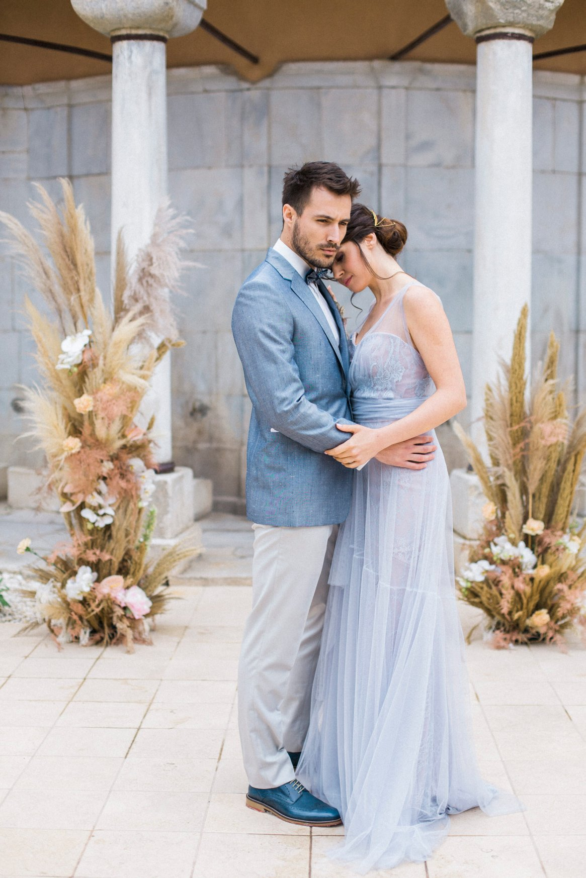 Luxury Elopement couple getting married in Kavala hotel with pampas grass